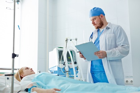 icu: Physician visiting his patient in icu Stock Photo