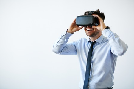 Portrait of excited businessman in vr goggles 스톡 콘텐츠