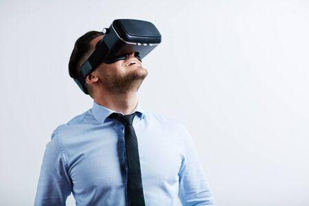 virtual reality simulator: Businessman enjoying virtual reality with simulator