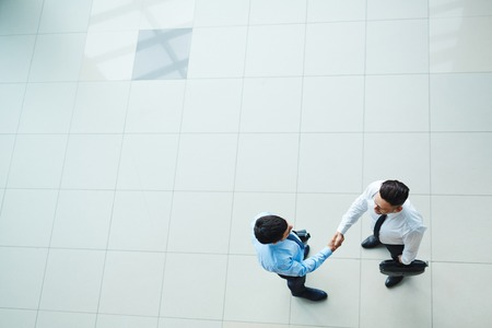 angle view: High angle view of businessmen shaking hands Stock Photo