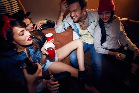 clubber: Swag friends with drinks enjoying party Stock Photo