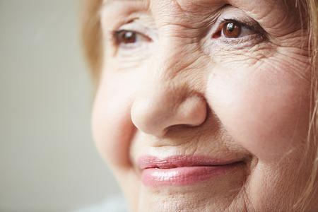 senior woman: Face of smiling senior woman Stock Photo