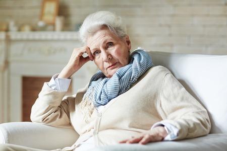 Serious pensioner looking at camera Stock Photo