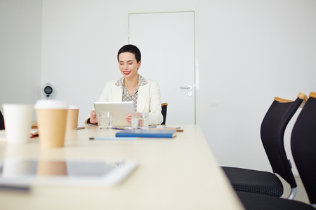 touchpad: Businesswoman with touchpad networking in office