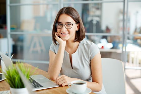 businesspeople: Successful young employee sitting at workplace