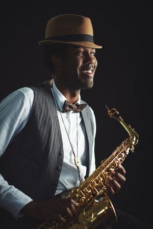 sax: Happy young jazzman with sax