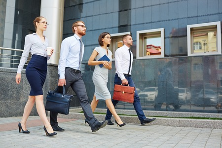 important people: Row of business people going to strike important deal Stock Photo