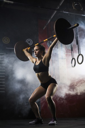 heavy weight: Woman lifting heavy weight in sports club