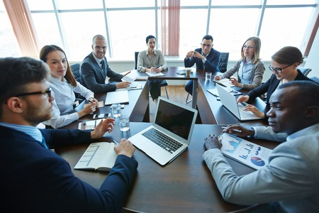 Business team discussing at board room Standard-Bild