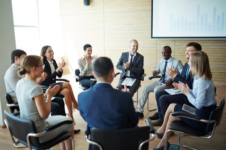 Business team applauding at a meeting