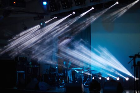 lighting effects musician: Stage with lights and popular group Stock Photo
