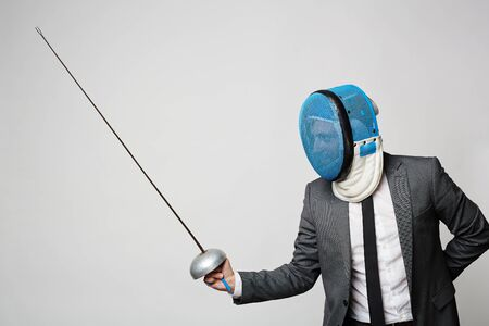 fencing foil: Businessman in suit with fencing foil