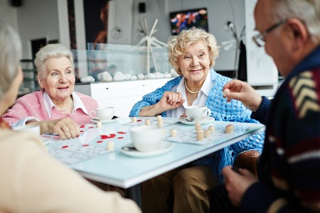 friendly people: Friendly people playing lotto in cafe