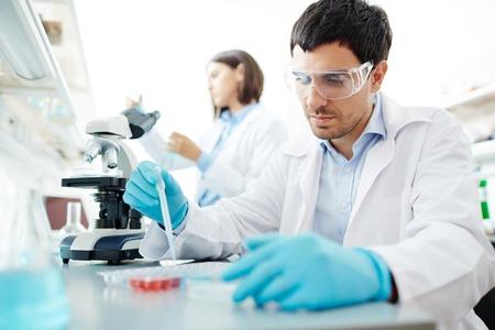 clinician: Male clinician testing new vaccine in lab