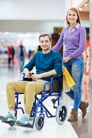 Amorous young couple looking at camera during shopping