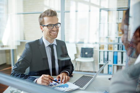 young business people: Happy young businessman looking at his partner during interaction
