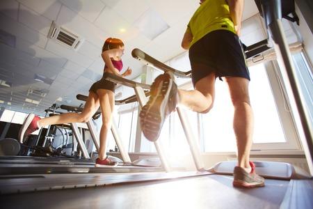 Young athletes running on treadmills photo