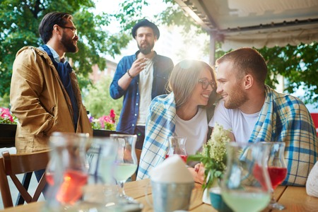 amorous: Amorous guy and girl looking at one another in cafe Stock Photo