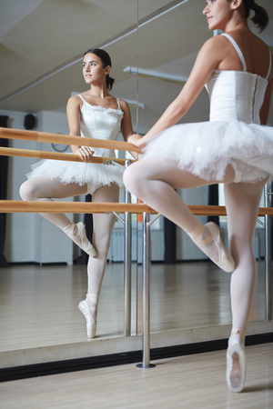 reflection in mirror: Young girl practicing ballet in class Stock Photo