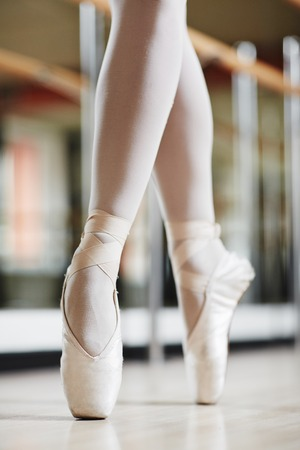 Legs of ballet dancer in pointes Stock Photo