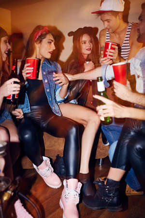 clubber: Cute friends enjoying swag party in club Stock Photo