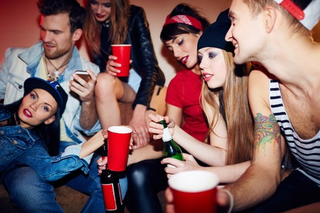 clubber: Group of teens relaxing in bar or club Stock Photo