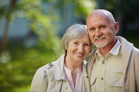 natural looking: Seniors looking at camera in natural environemnt