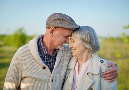 couples hug: Romantic couple enjoying togetherness on retire Stock Photo