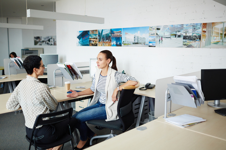 discussing: Confident females brainstorming while discussing working plans Stock Photo