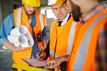 inspectors: Inspectors discussing draft of new construction