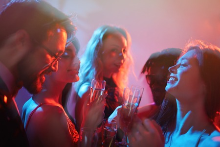 festive occasions: Happy girl and her friends enjoying party in club