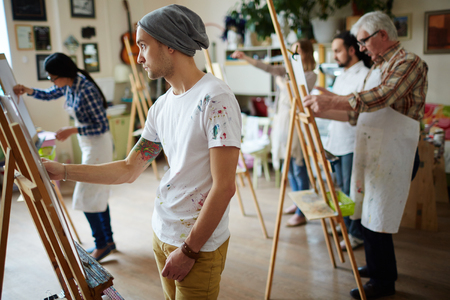 Group of students painting at art lessons Stock Photo
