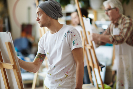 skill: Young man learning to draw at art class Stock Photo