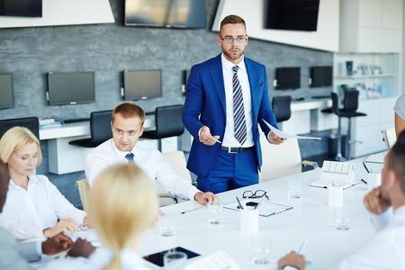 briefing: Elegant businessman explaining his viewpoint at briefing