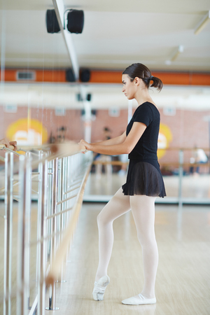 choreographic: Young ballerina during repetition of choreographic exercises