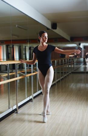Ballerina exercising in ballet class Фото со стока - 61283273