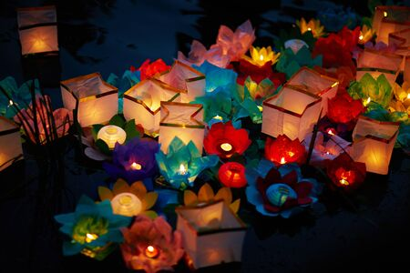lotus lantern: Background of traditional festive floral lanterns with burning candles inside