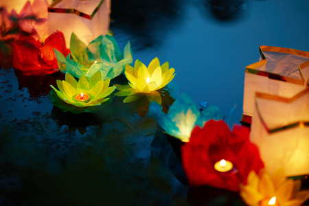 Group of floral lanterns floating on surface of lake or river Stock Photo