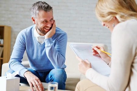 Happy man talking to his psychologist
