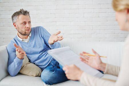 describing: Man describing his problem to psychologist