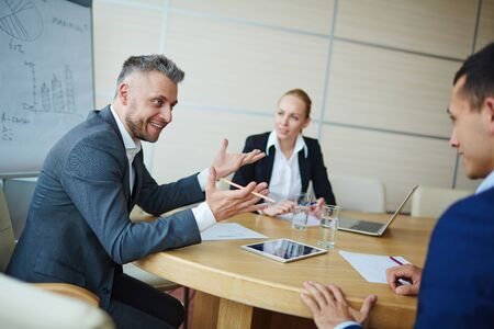 one people: Successful employer talking to one of hiring people