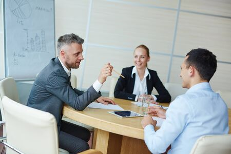 discussing: Group of confident managers discussing working plans