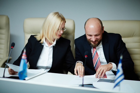 politicians: Two politicians in formalwear working with documents Stock Photo