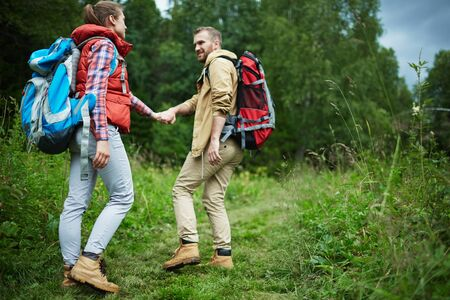 Girl following her boyfriend during trip
