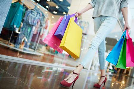 shopper: Casual shopper walking in trade center