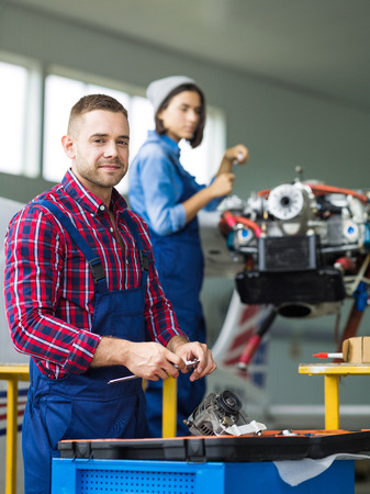 young engineer: Young engineer with working tool looking at camera