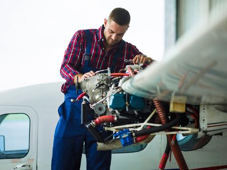 Contemporary workman repairing air vehicle Stock Photo
