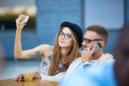 contemporary: Contemporary couple using modern gadgets
