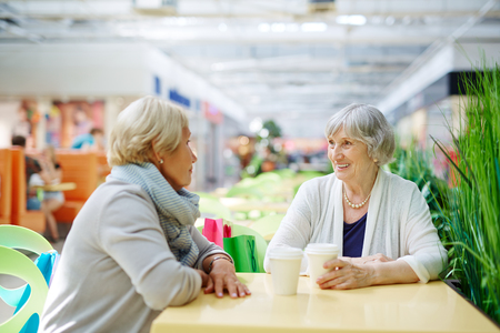 women coffee: Two aged females having rest in cafe Stock Photo