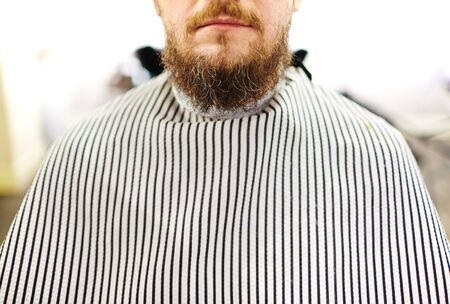 barbershop: Close-up of bearded man sitting in barbershop Stock Photo